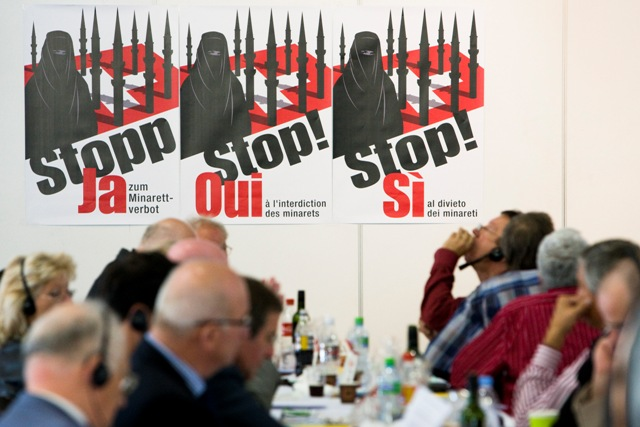 "(Photo: Poster to vote ""yes"" to minaret ban in a Swiss meadow, 13 Nov 2009/Dario Bianchi)"
