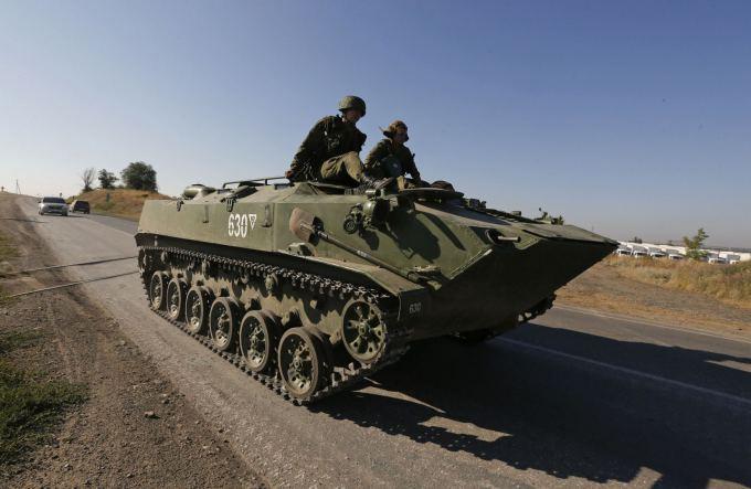 """""""Reuters""""/""""Scanpix"""" nuotr. / Rusijos kariai netoli Ukrainos sienos"""